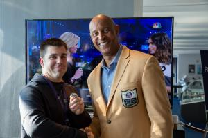 James Lofton with guest wearing ring