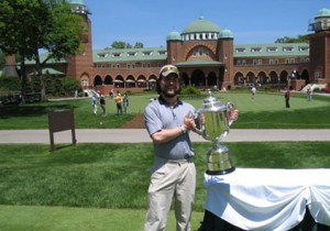 VIP Client holds PGA Trophy