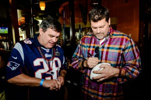 Celebrity guest Mark Schlereth (right) signing autographs