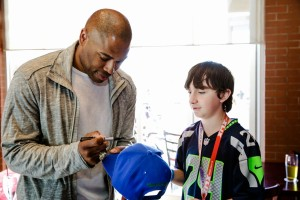 Seahawk's great Shaun Alexander signing autographs for fans