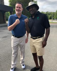 Boxing legend, Evander Holyfield, with VIP Staff at The Masters